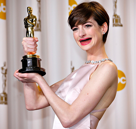 "Anne Hathaway holds her Oscar for winning Best Supporting Actress for her role in ""Les Miserables"" in Hollywood"