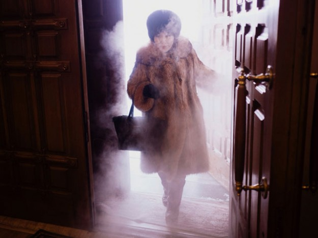 A local woman enters Preobrazhensky Cathedral in a swirl of freezing mist.